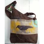 sac brun avec oiseau noir